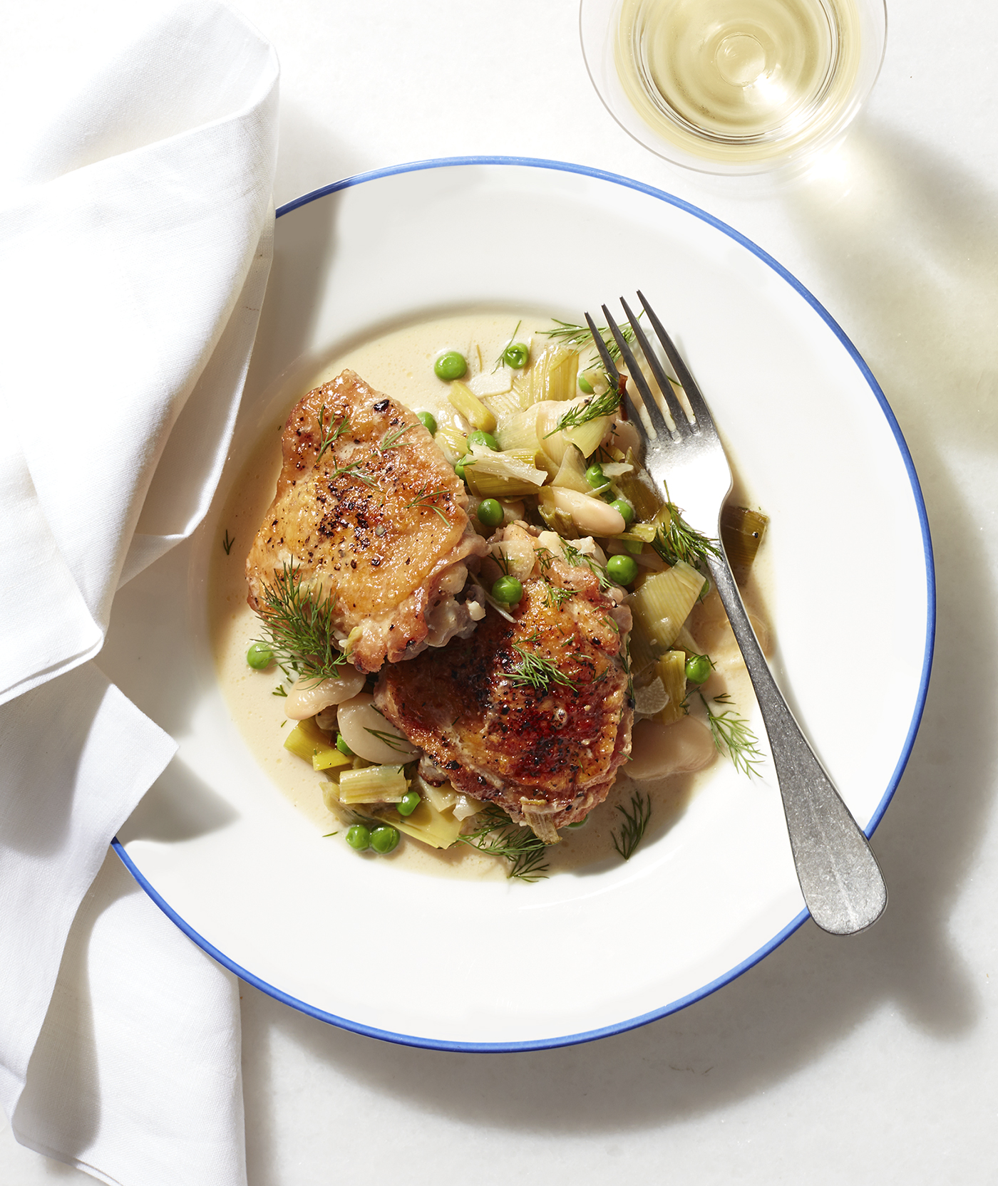 Braised Chicken With Leeks, Peas, and Butter Beans