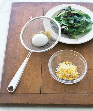 Mesh strainer used to crumble eggs