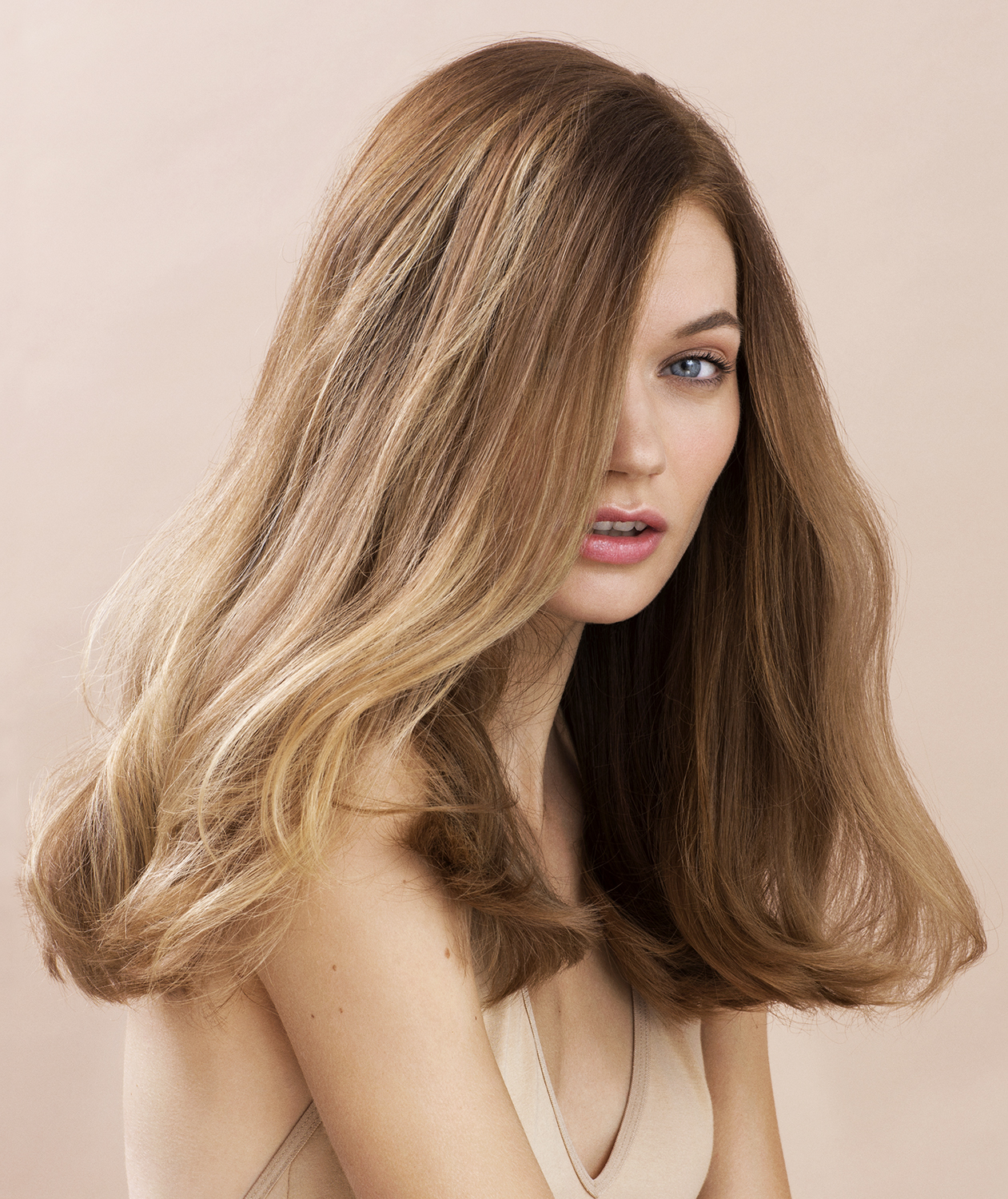 Model with thick dark blonde hair
