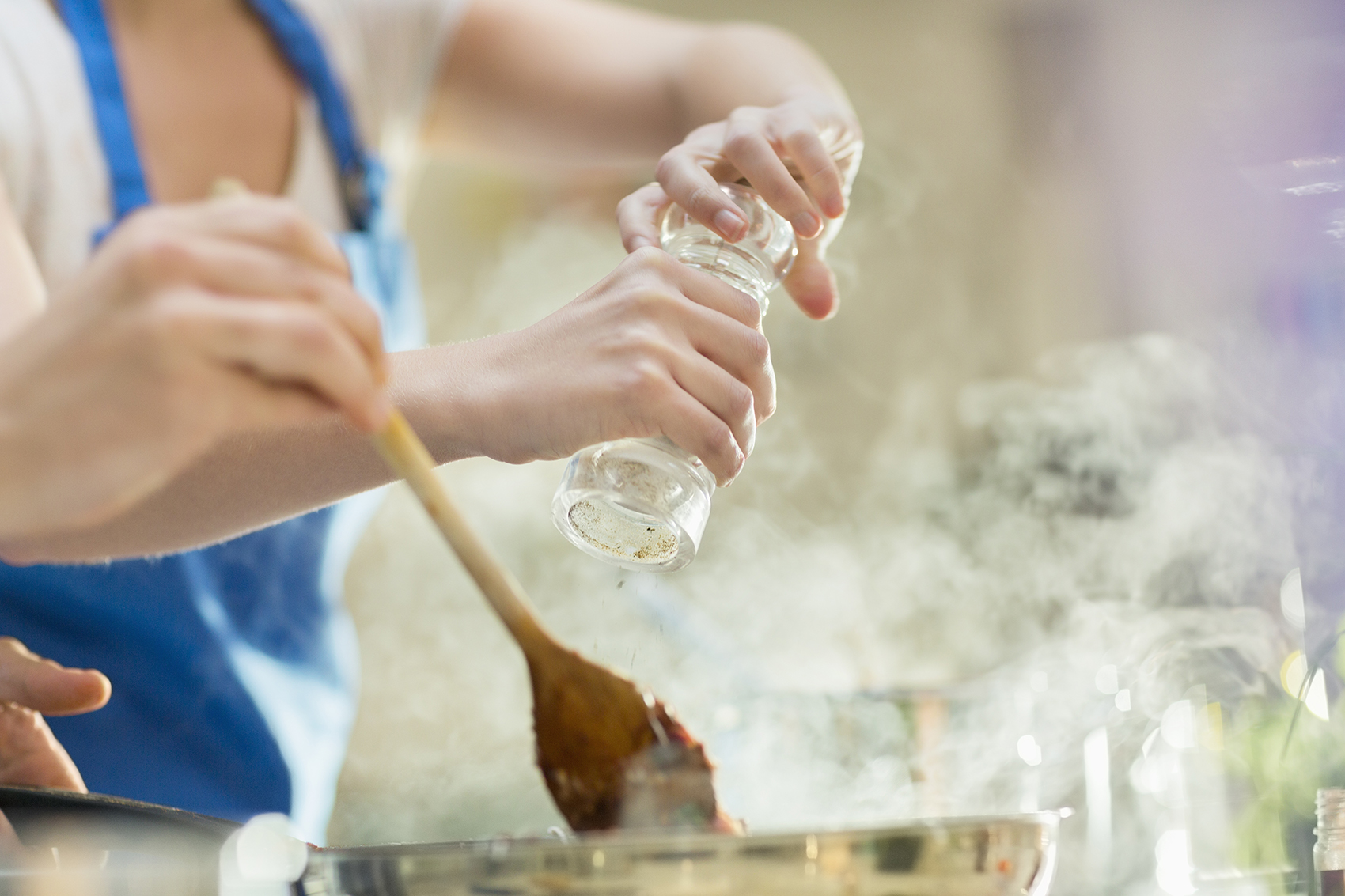 Two people cooking in kitchen