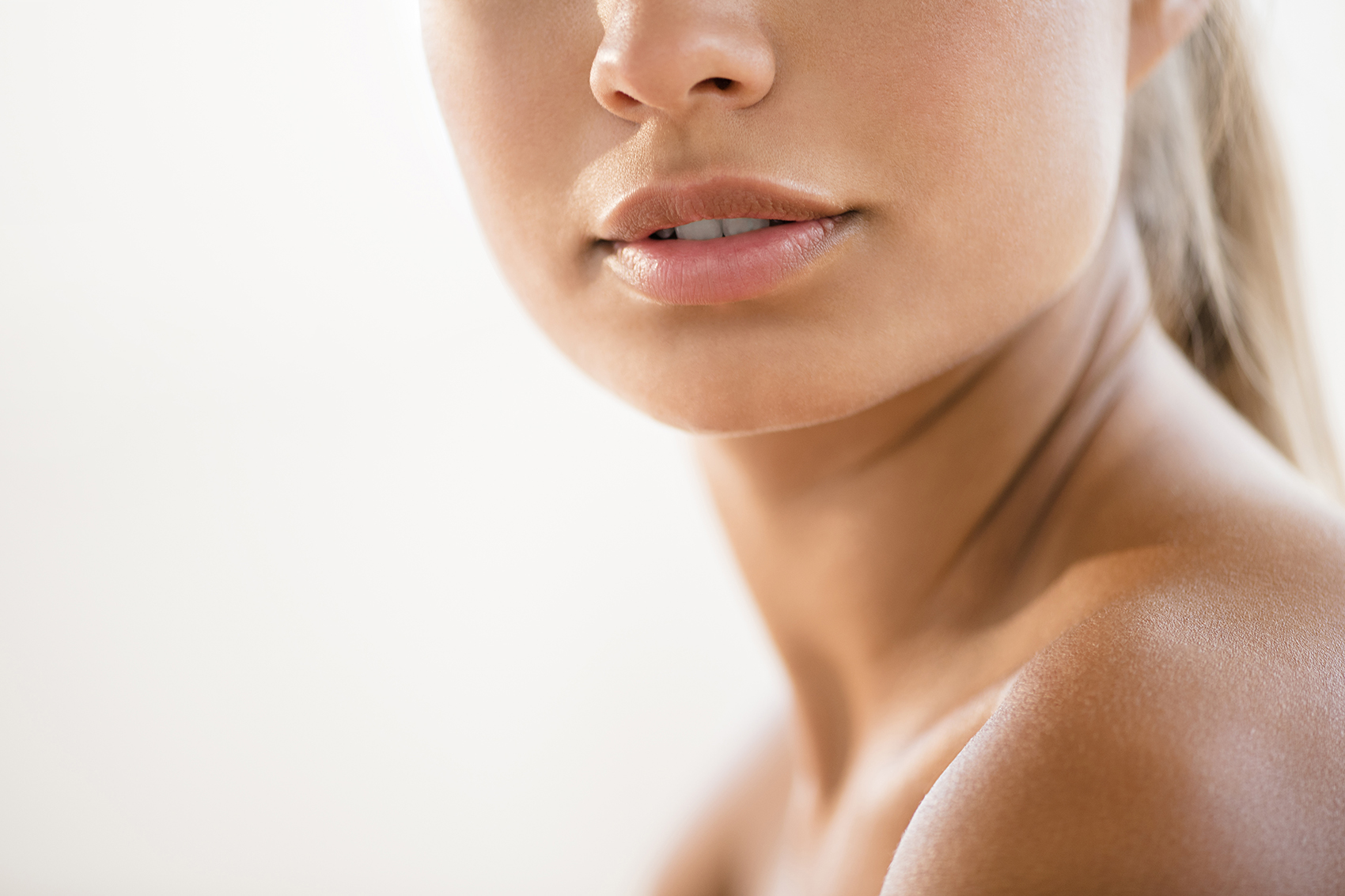 Close up of bare lips and shoulder