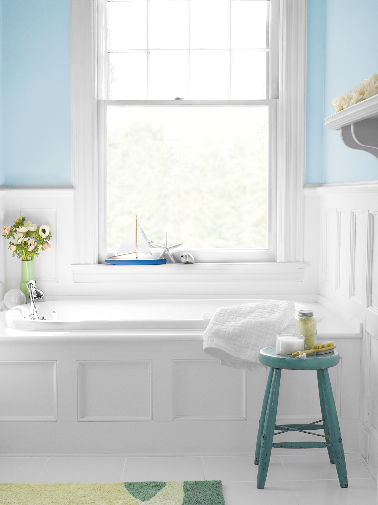 Clean bathtub in white and blue bathroom