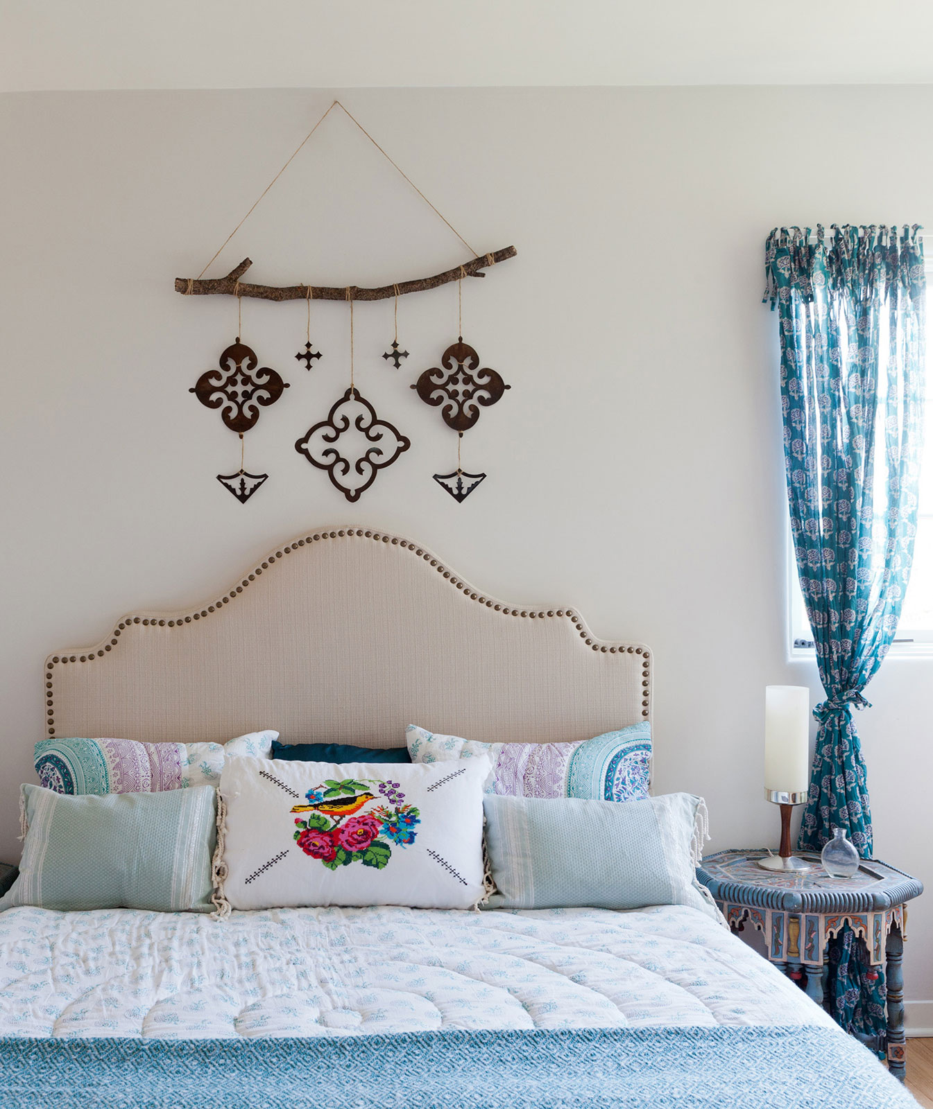 Bedroom with wall hanging and blue accents