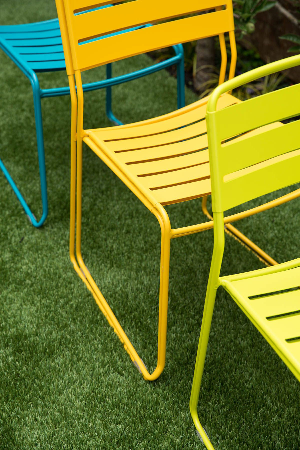 Colorful foldable chairs on lawn