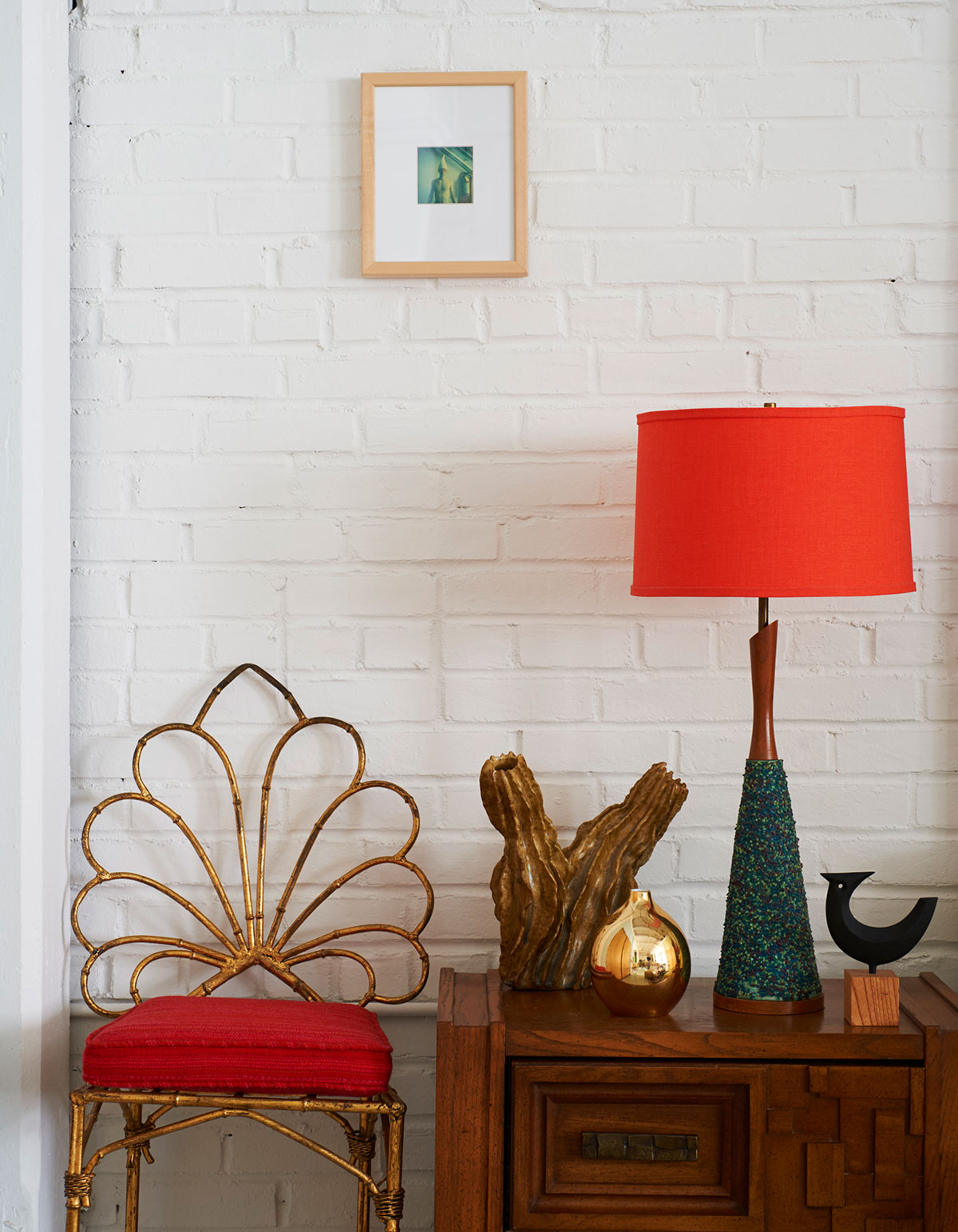 Interior vignette with red lamp and chair