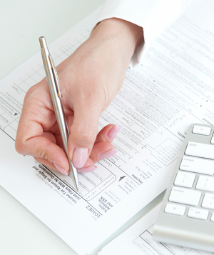 Person filling out tax return form