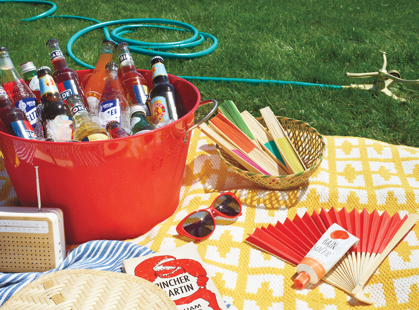 Bottled drinks in red bin at a picnic