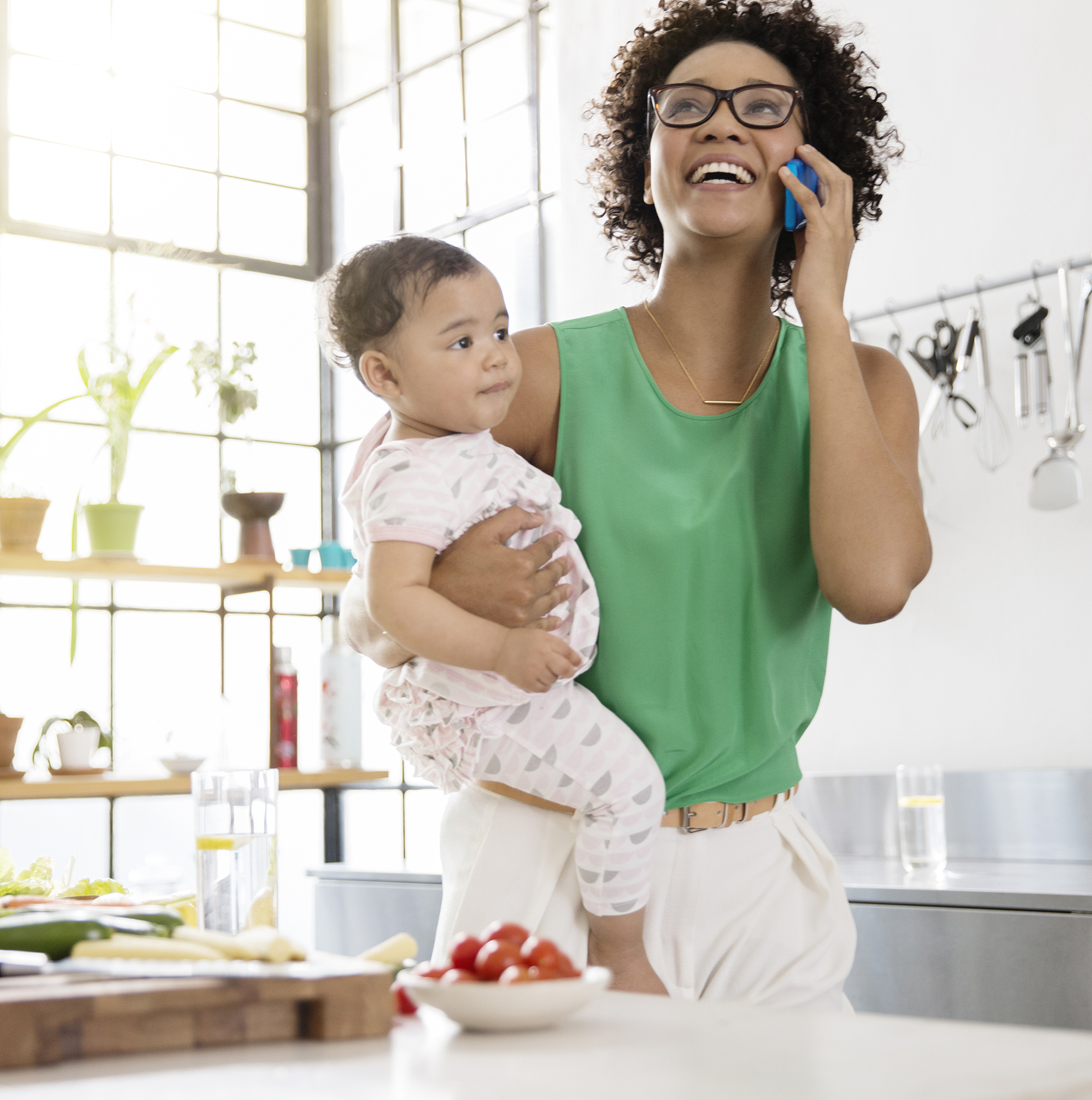 Mom on work call with daughter in kitchen
