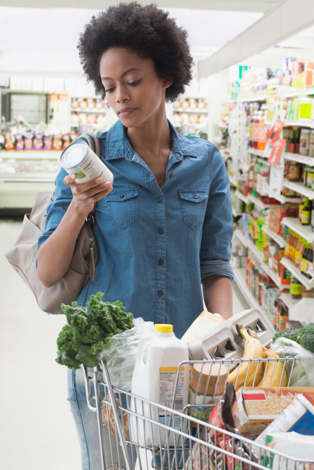 Woman looking at nutrition label