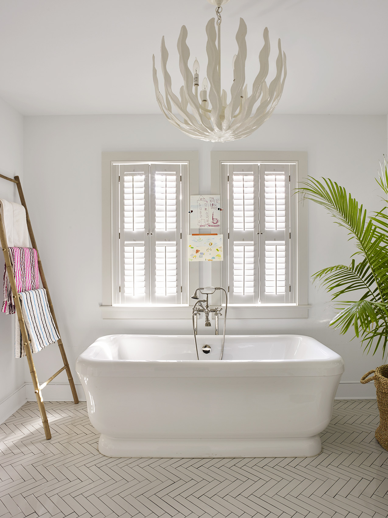 White bathroom with white chandelier