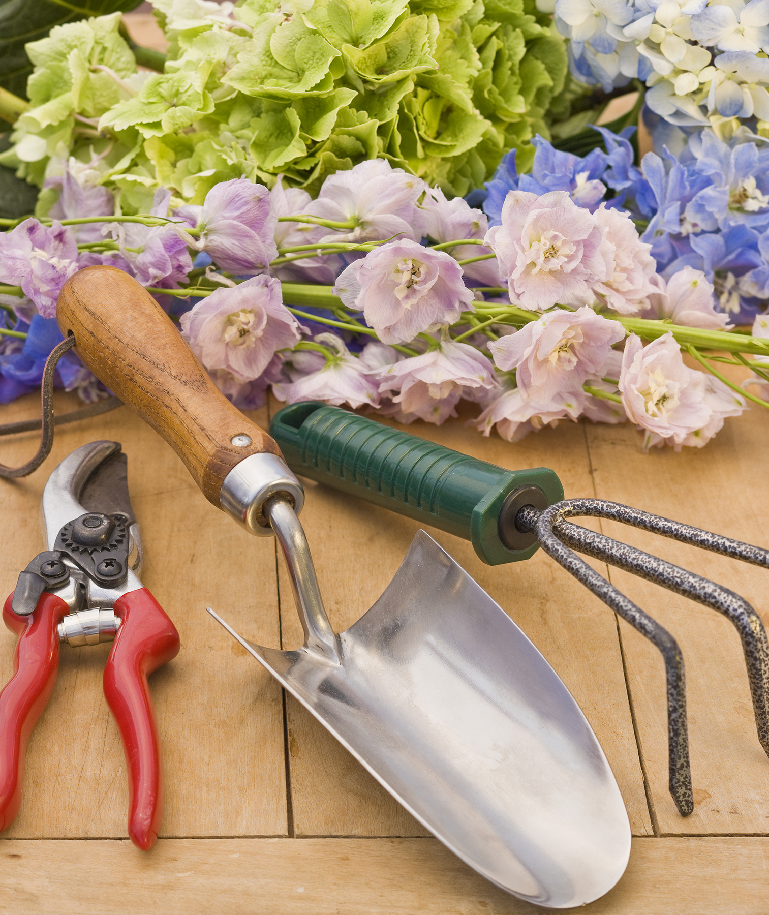 Gardening tools with flowers