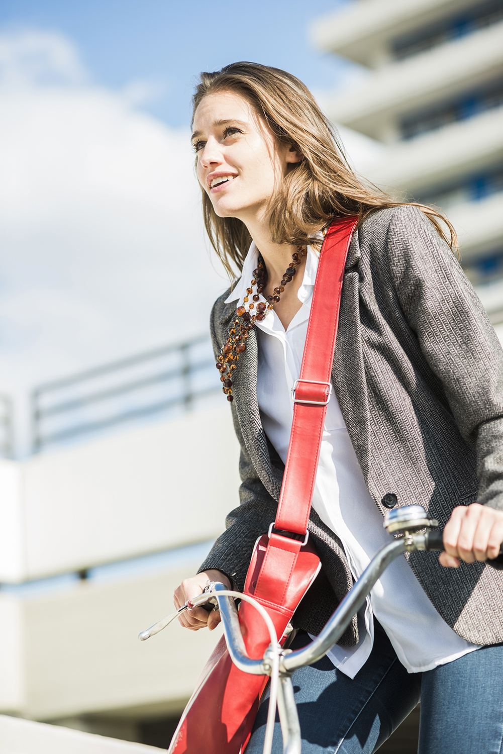 Smiling young woman with bicycle