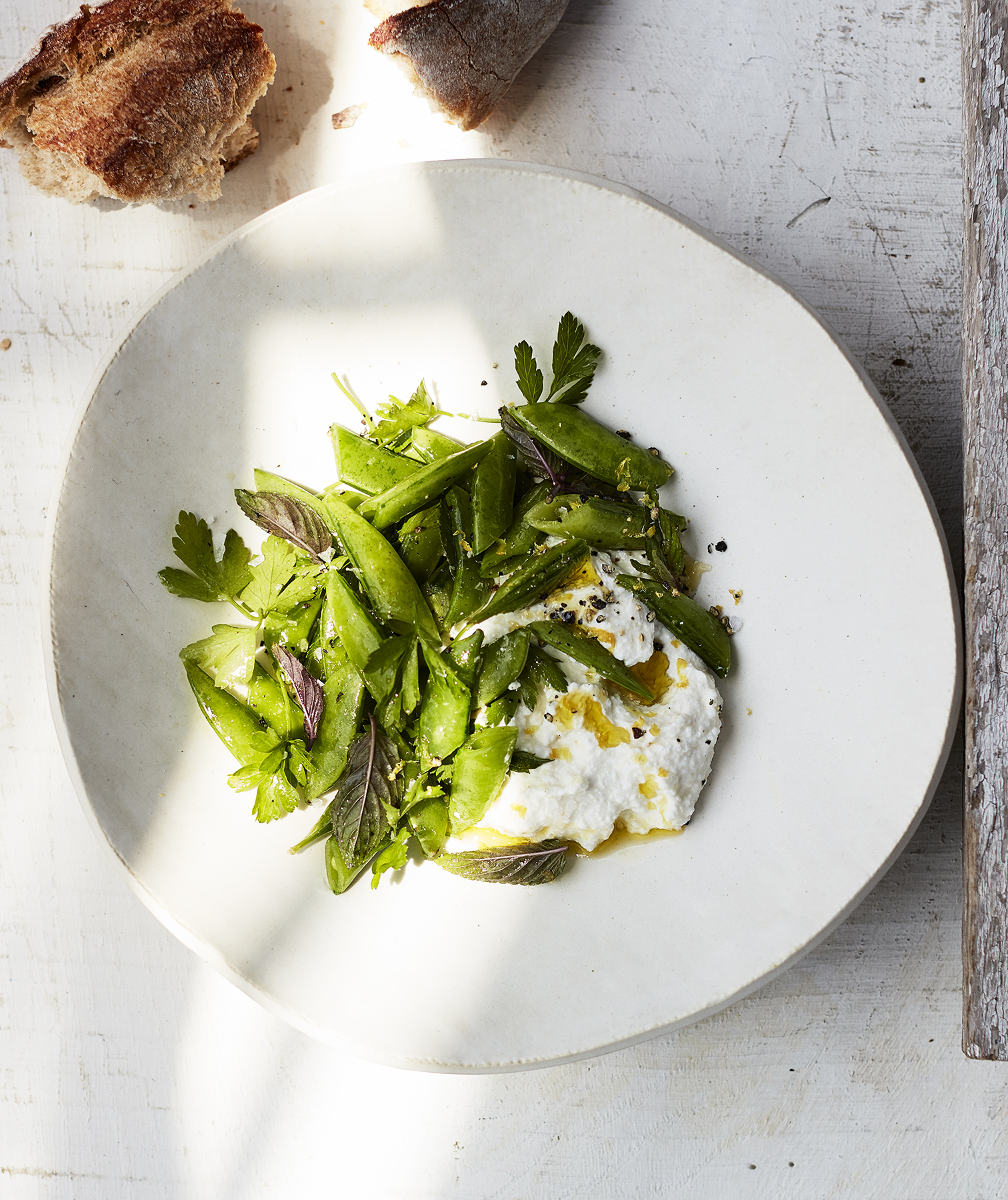 Sugar Snap Peas With Lemon Ricotta, Mint, and Parsley