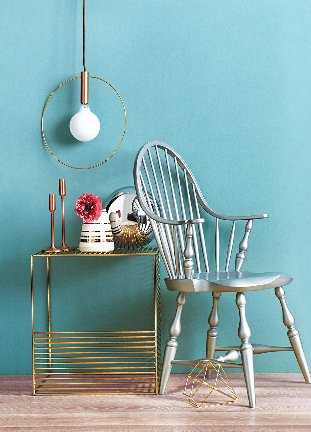 Silver and gold furniture with blue wall
