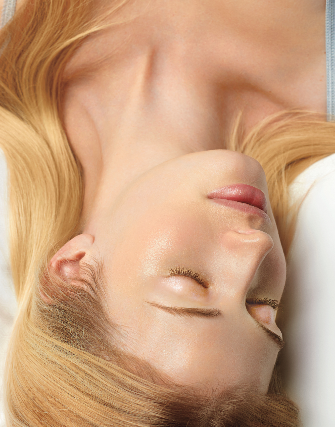 Woman laying down with clear skin