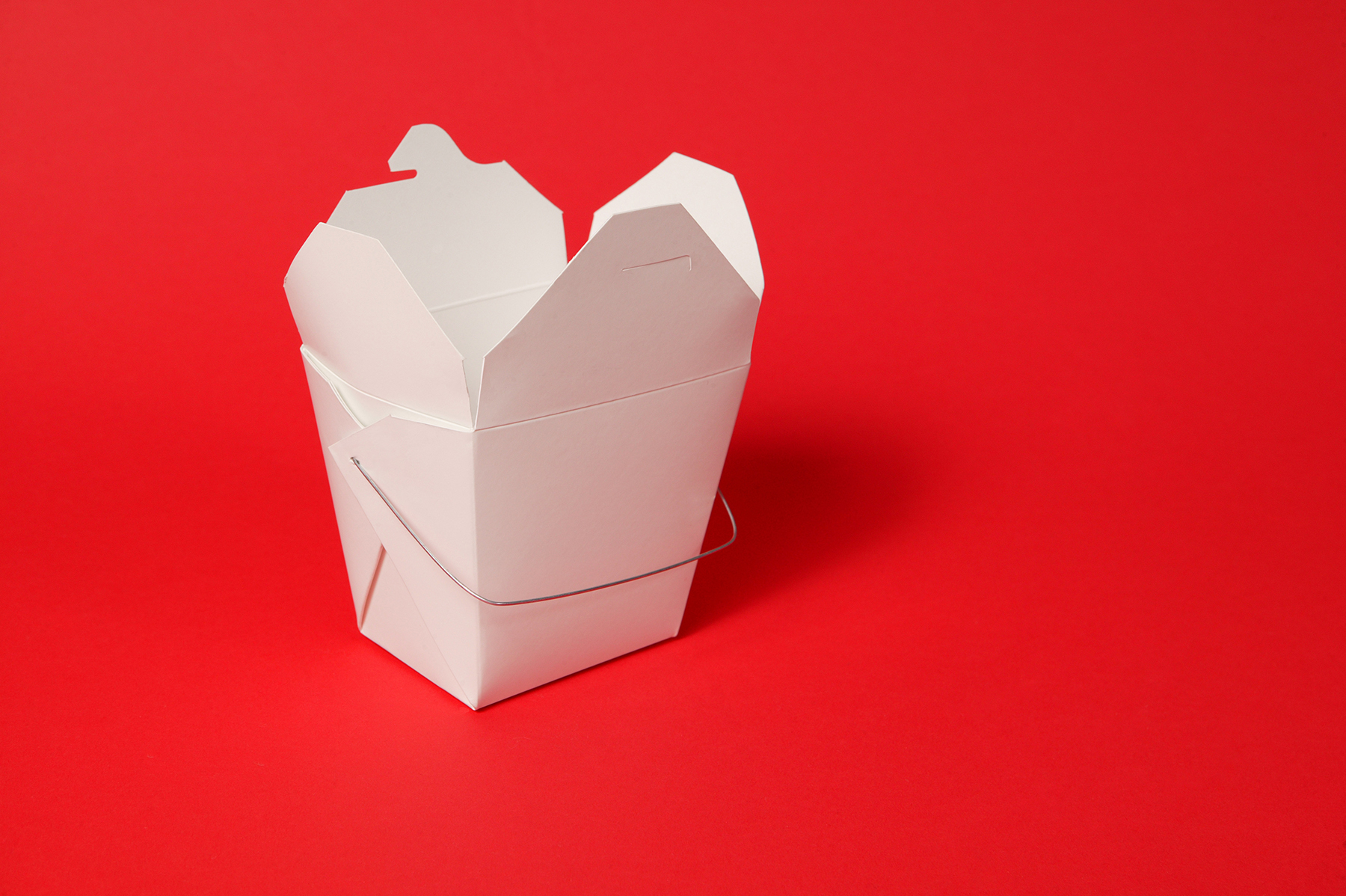 Takeout container on red background