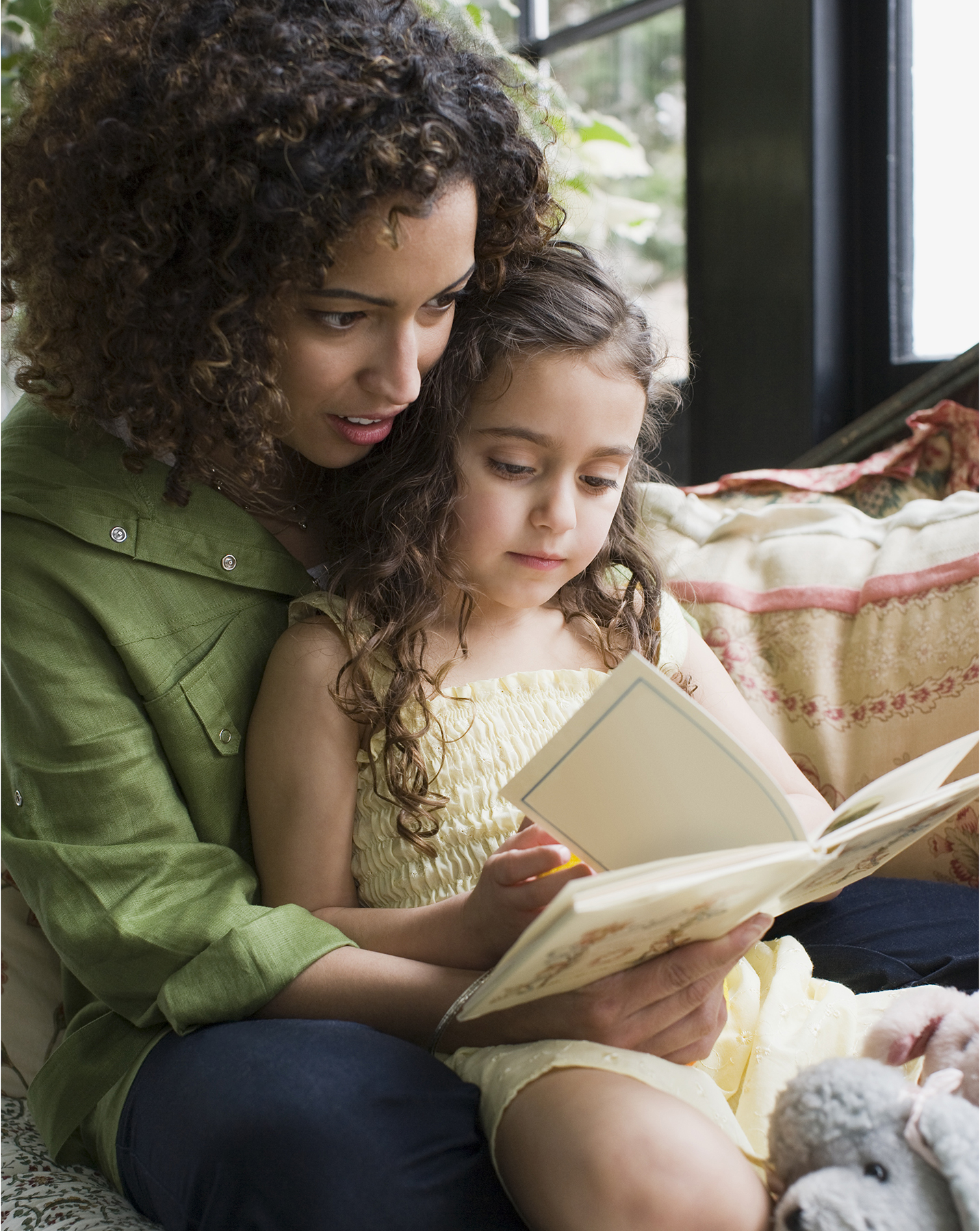 Woman reading with her daughter