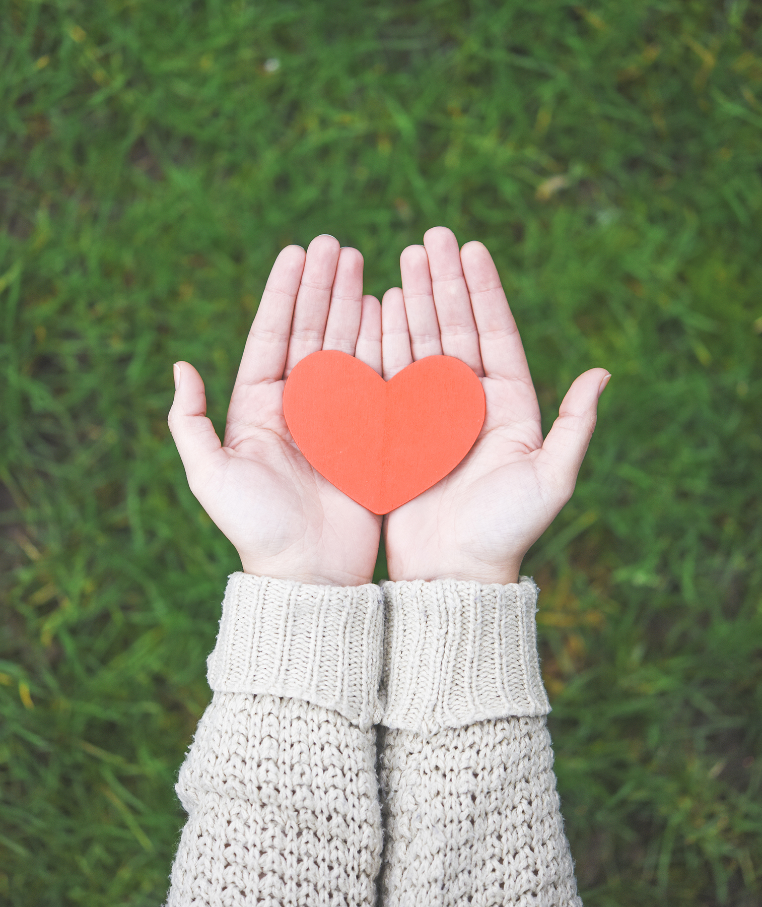 Woman with heart in hands