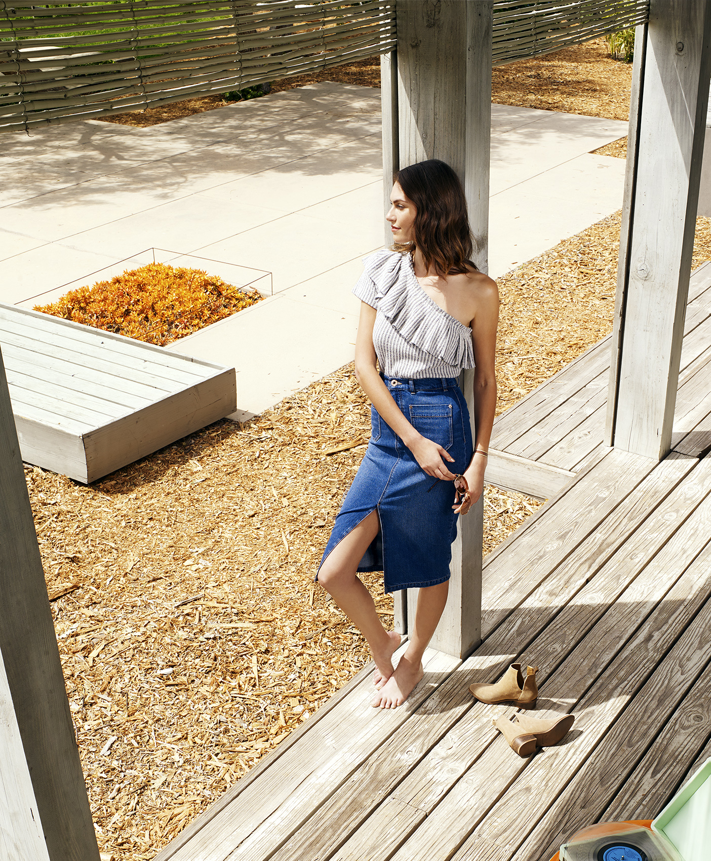 Model on porch in summer clothes