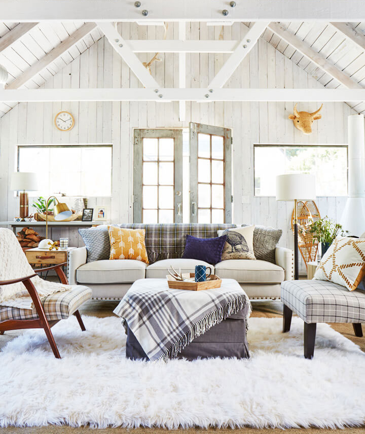 Living room with beams and mixed prints