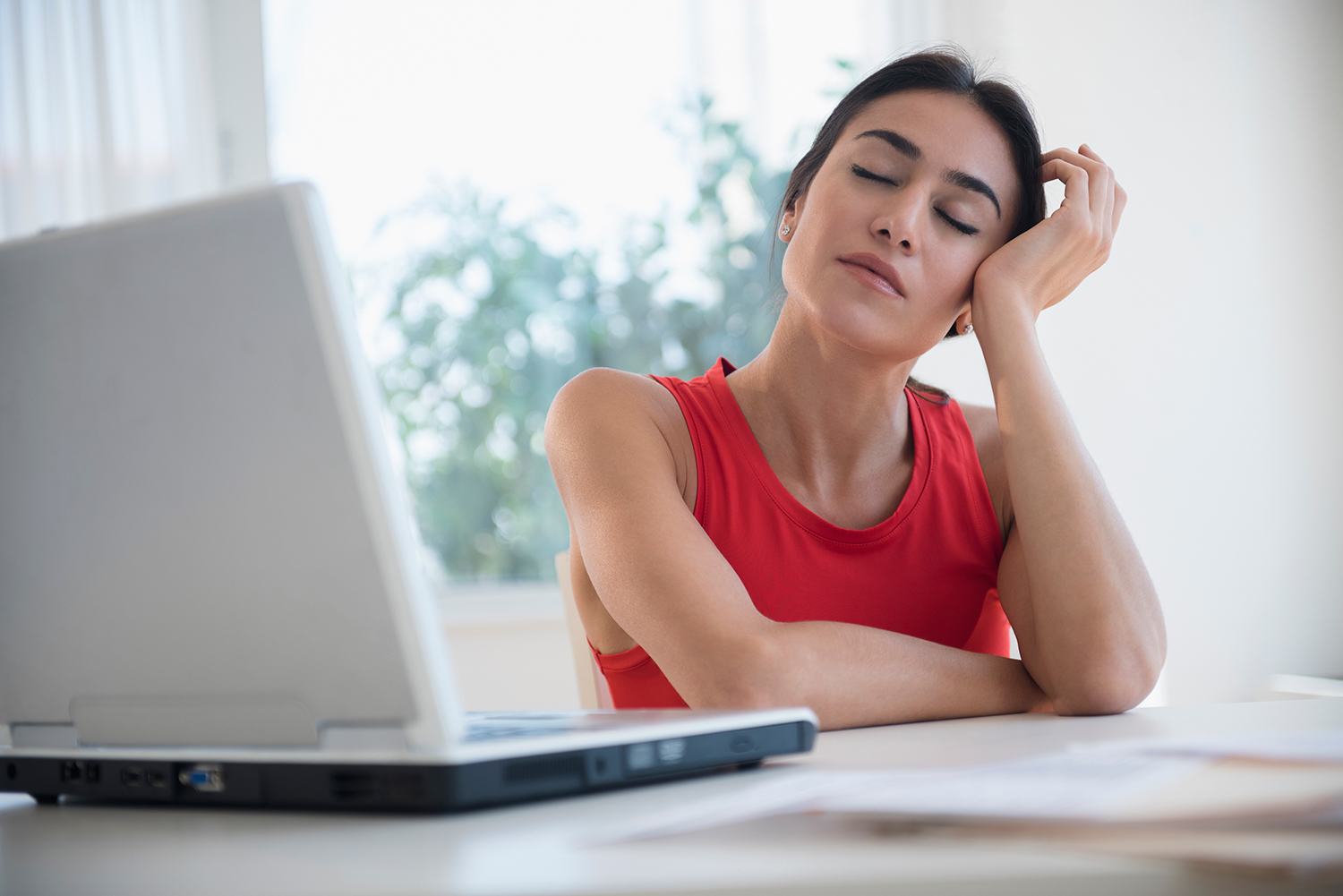 Woman Drifting Off at Her Desk