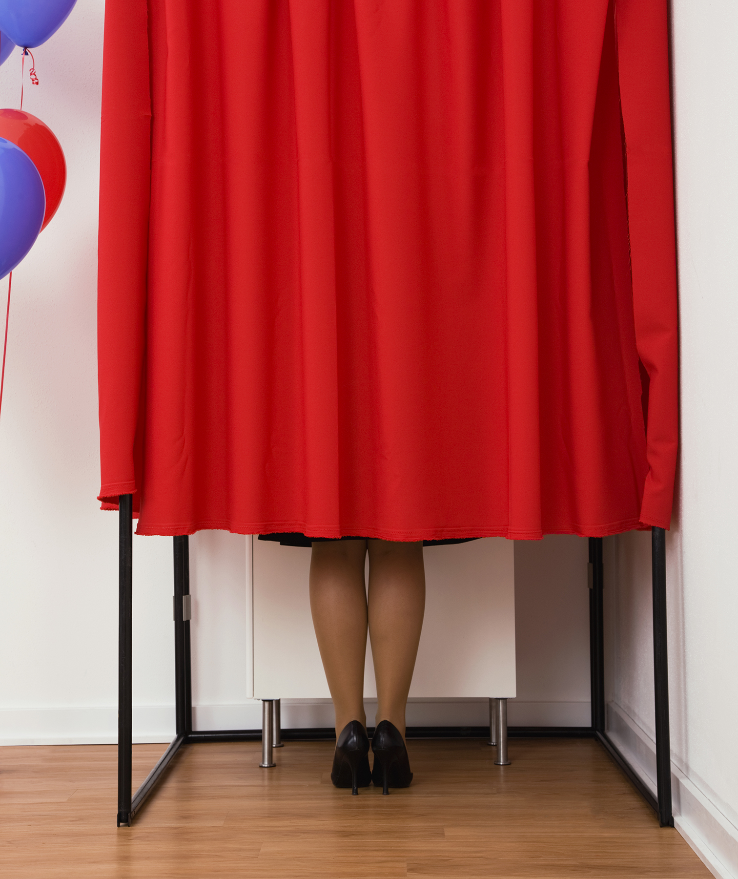 Woman in voting booth