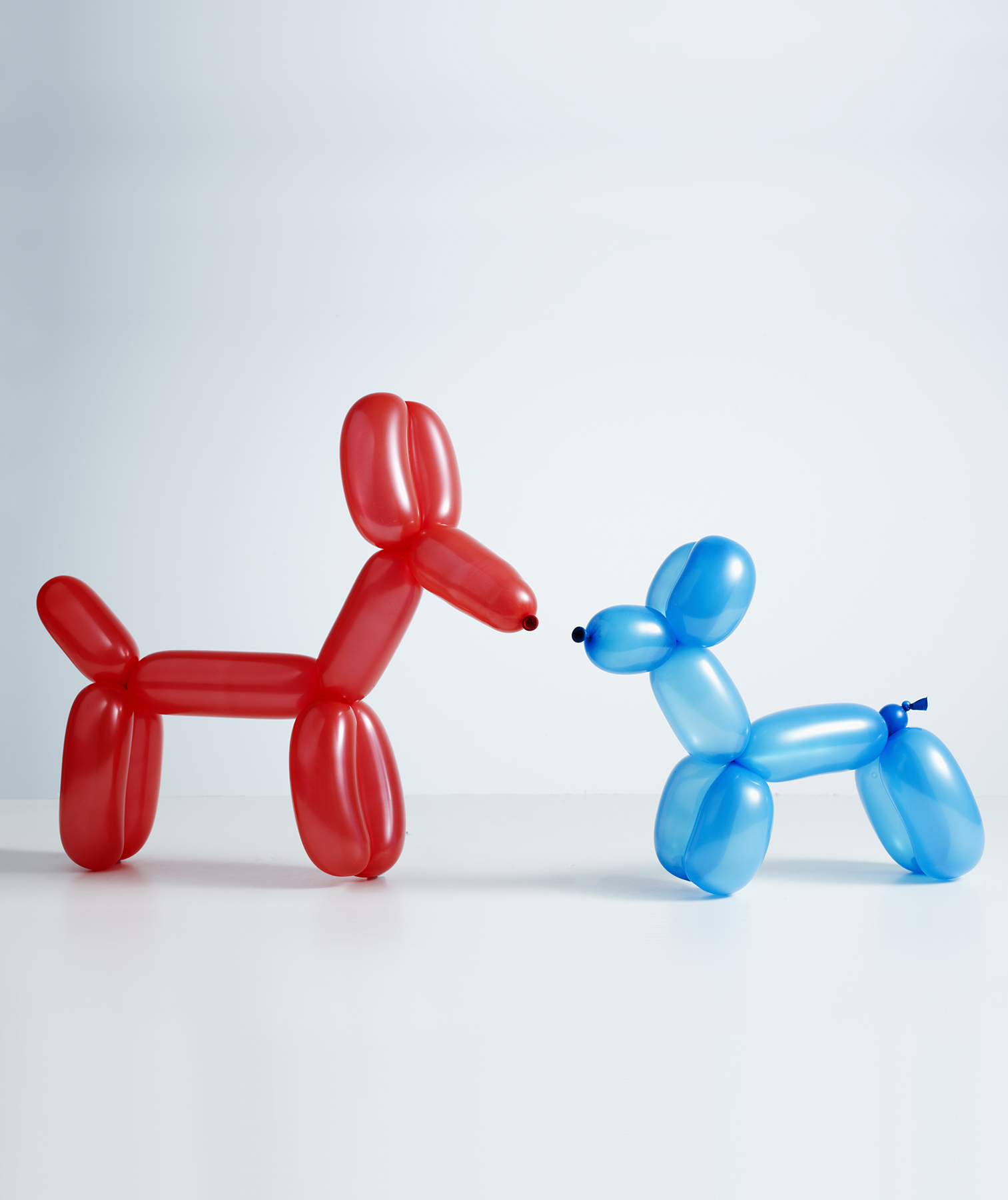 Red and blue balloon animals