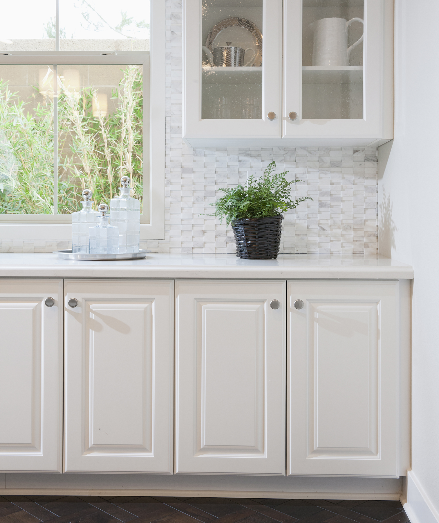 White kitchen cabinets with raised panels