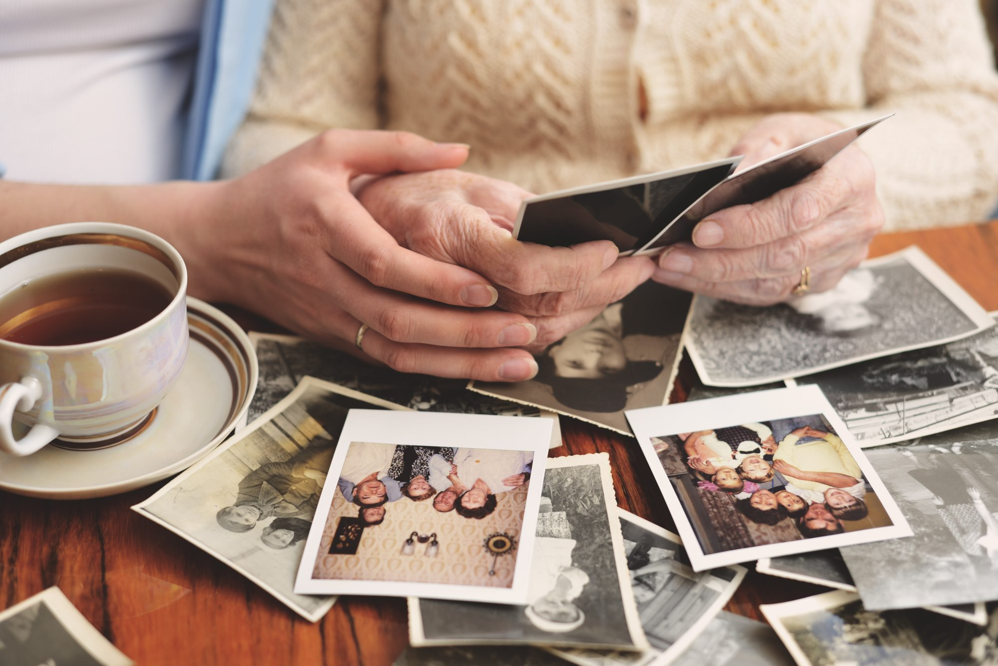 Woman looking at old photos