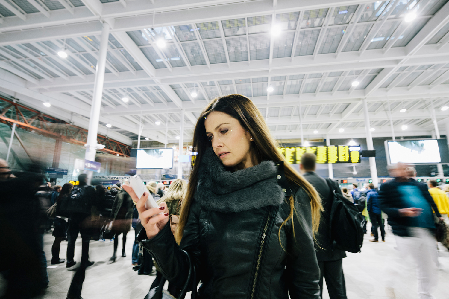Woman at Busy Airport