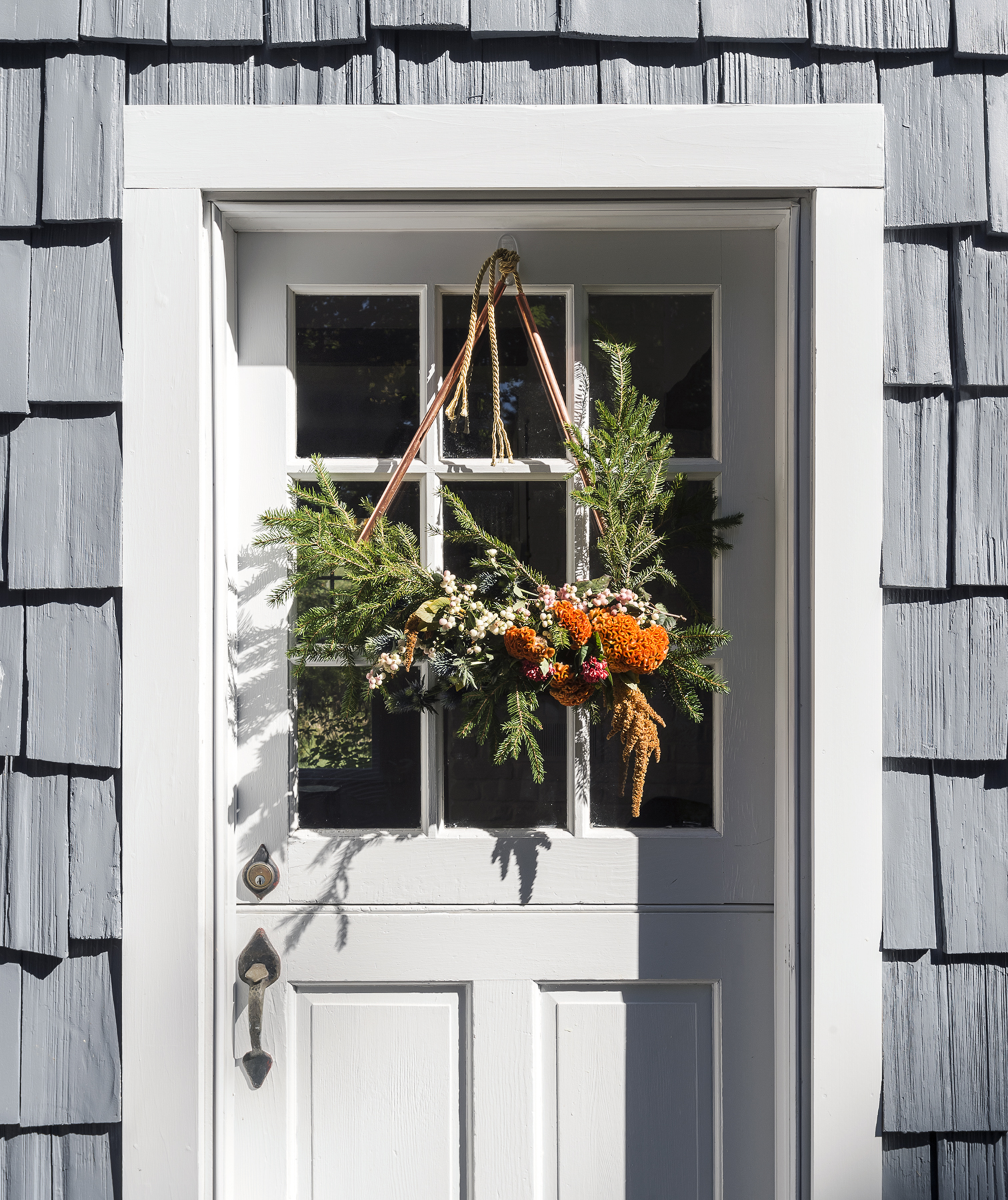 Copper pipe and floral door decor
