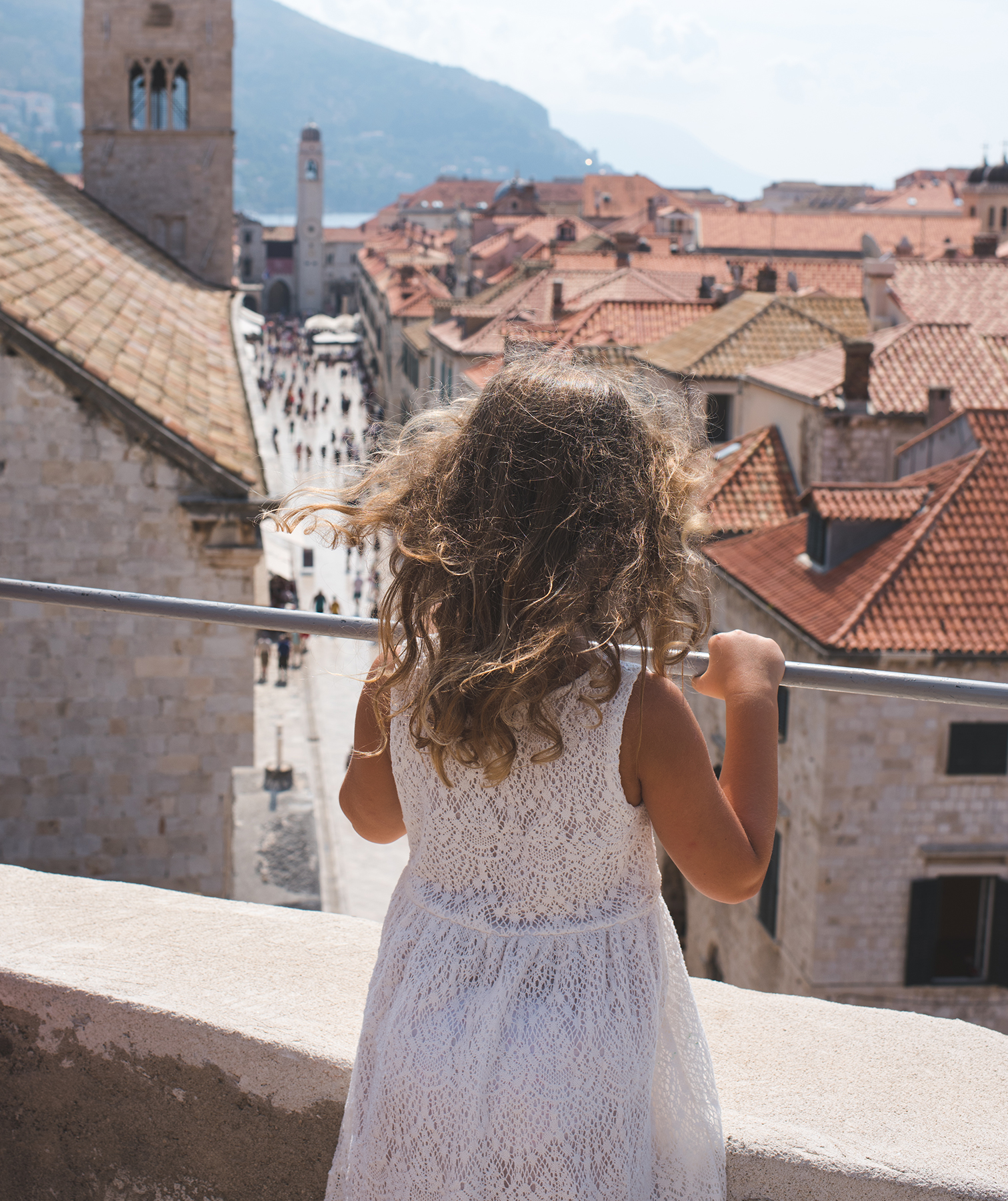 Girl looking out over view of Dubrovnik, Croatia