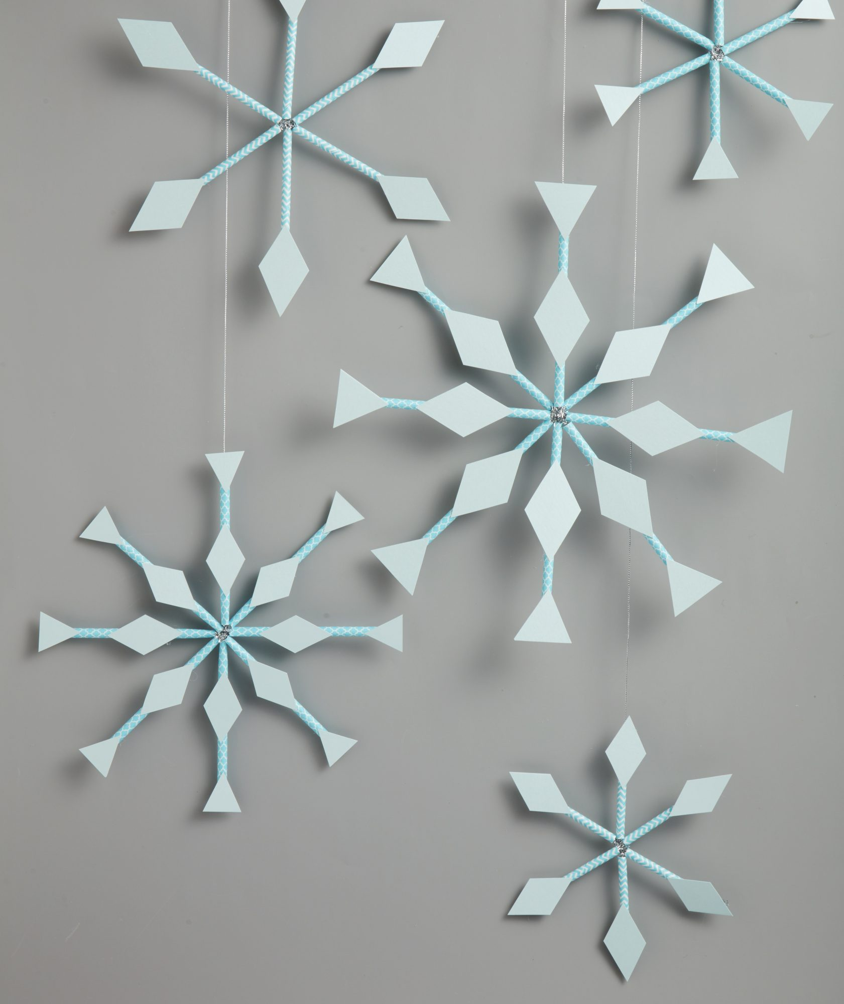 Snowflake decorations and snowflake crafts - Paper Straw Snowflake Window Hangings