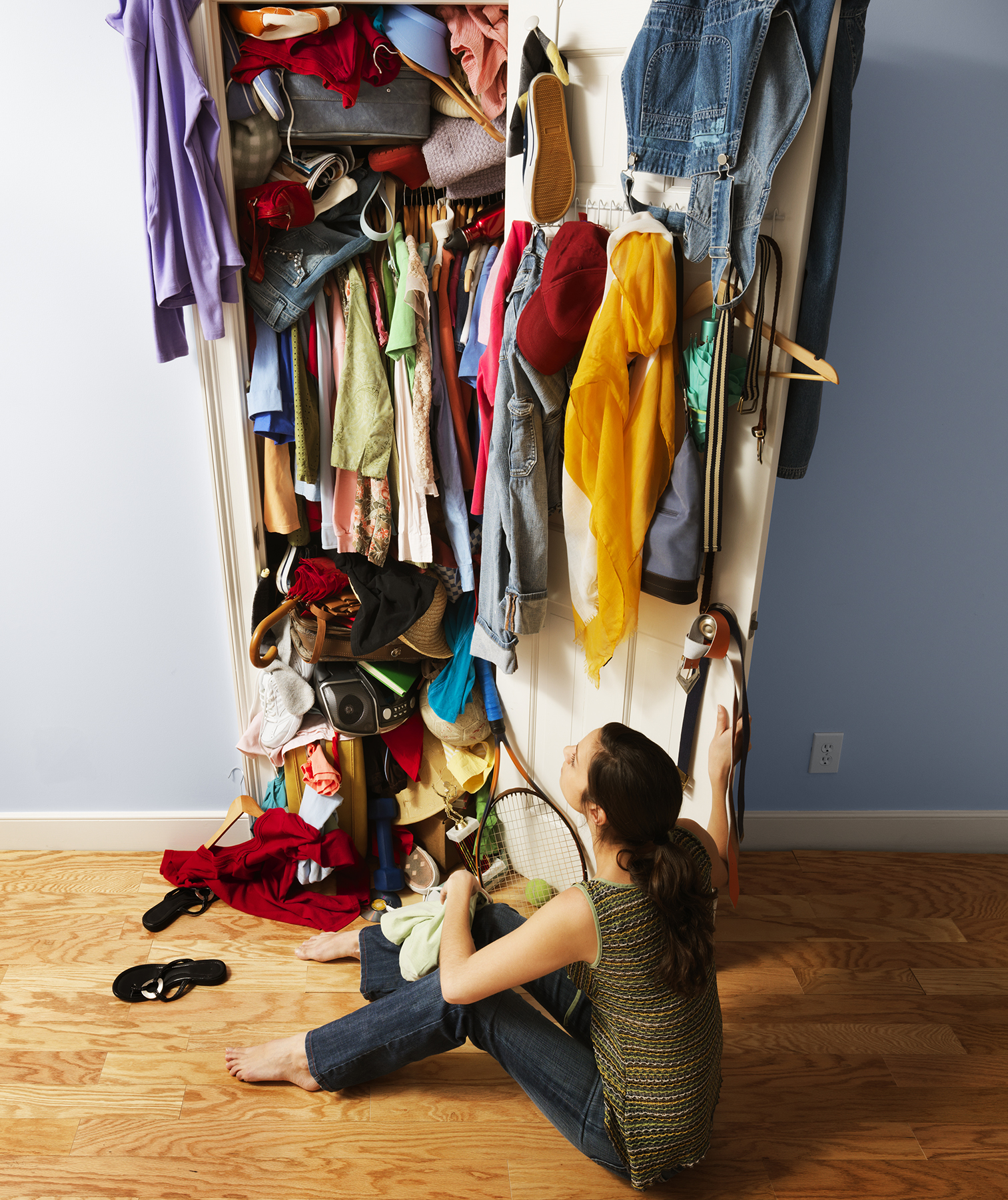 Woman in front of messy closet