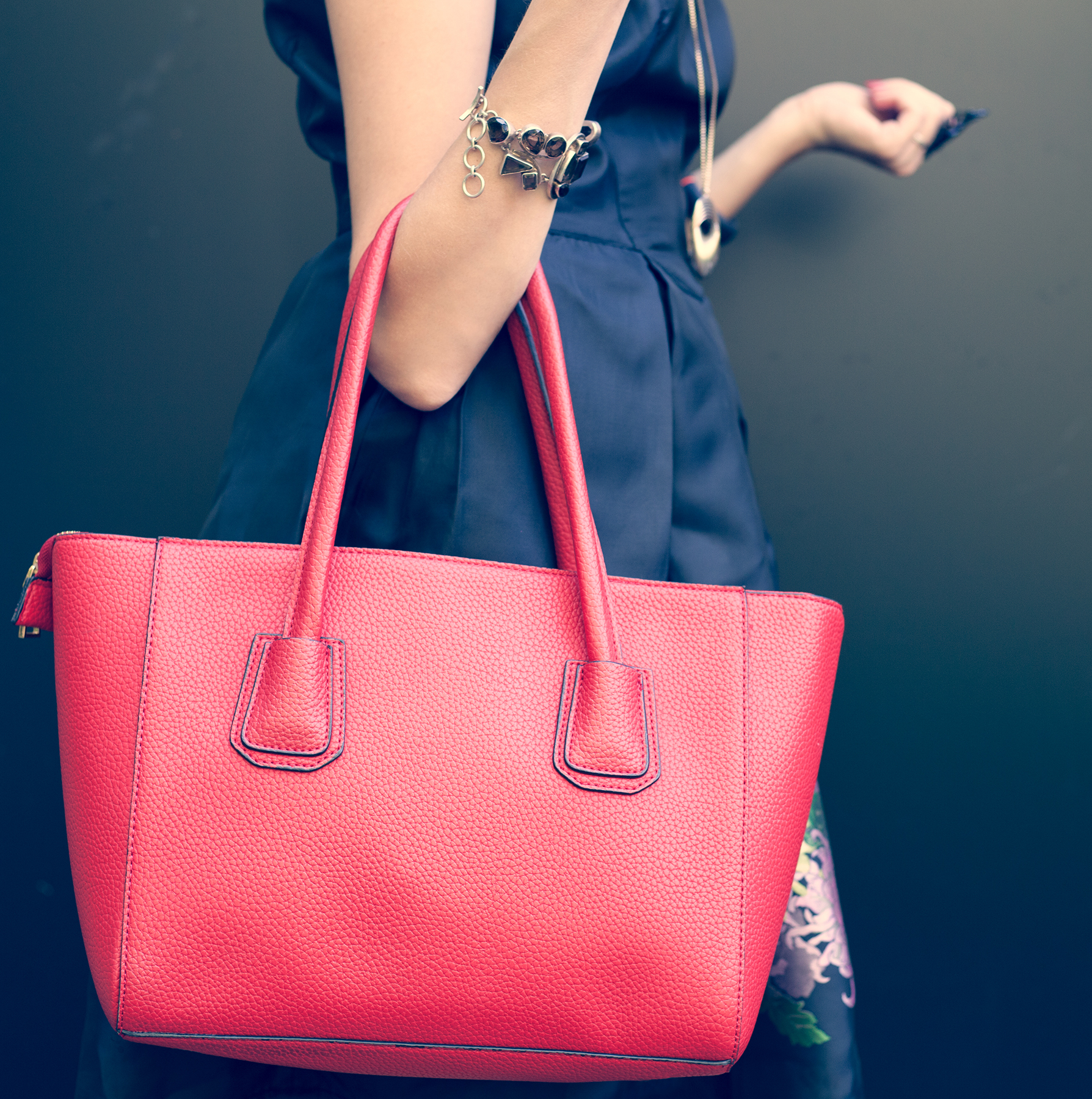 Woman holding red purse