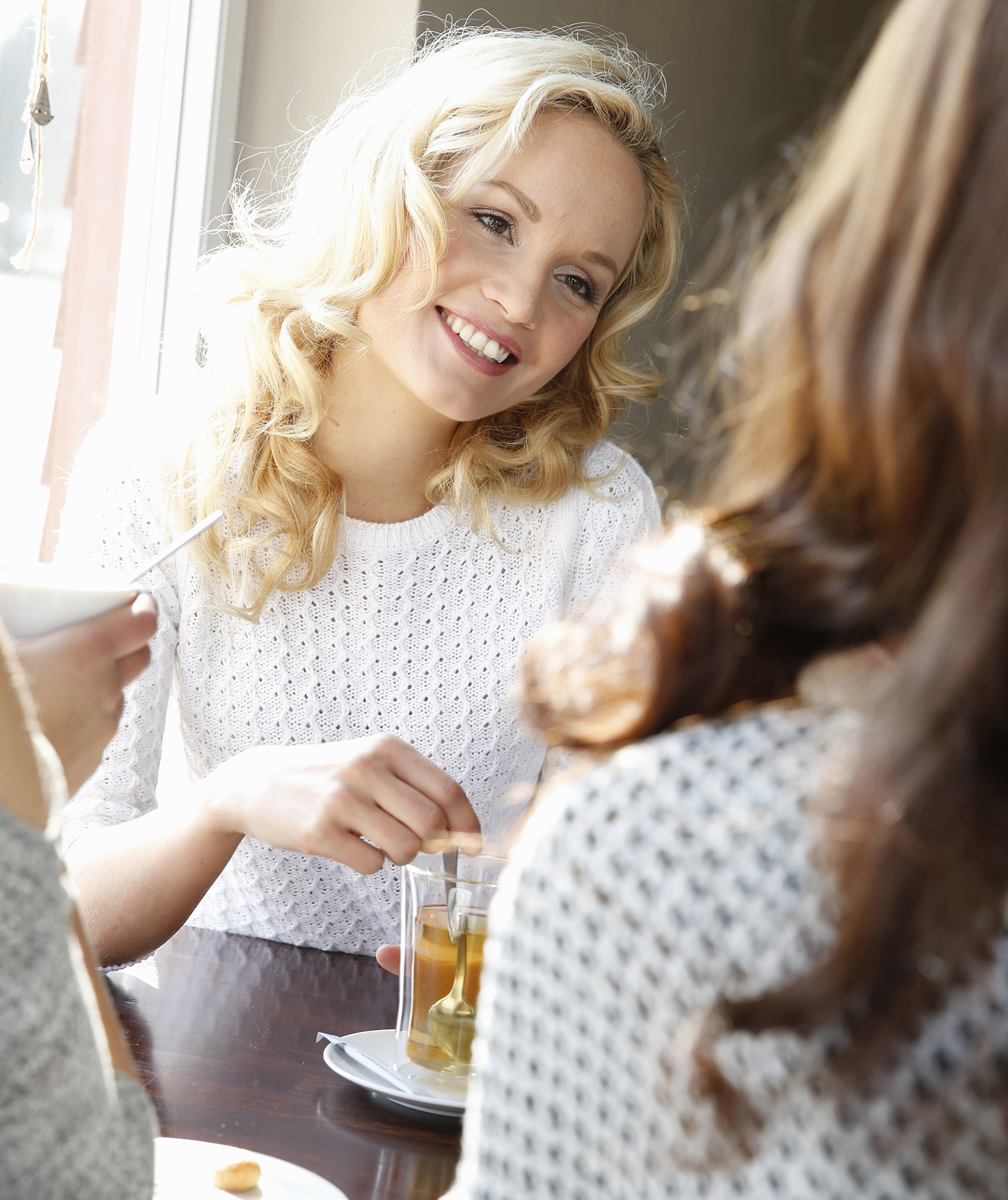 Three women chatting in cafe