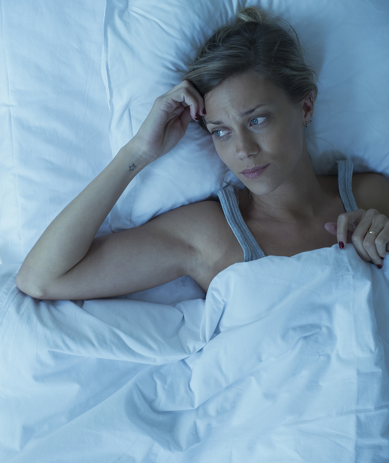 Woman lying awake with her thoughts
