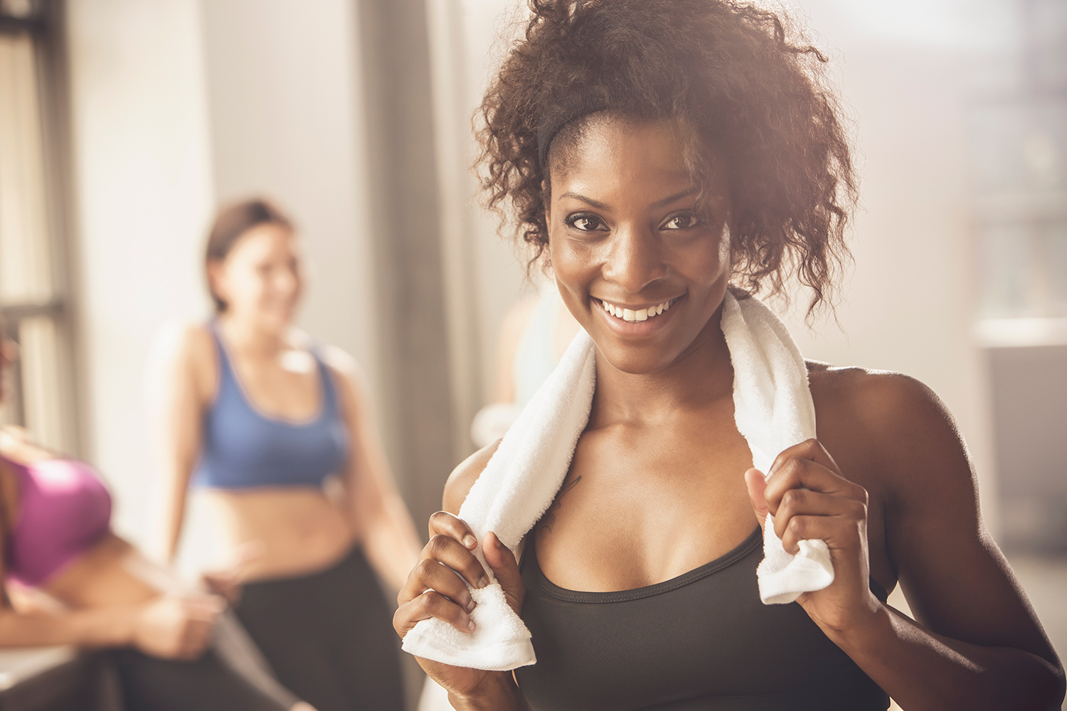 Woman Smiling and Working Out