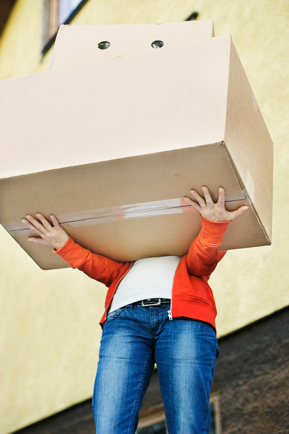 Woman Holding Large Box