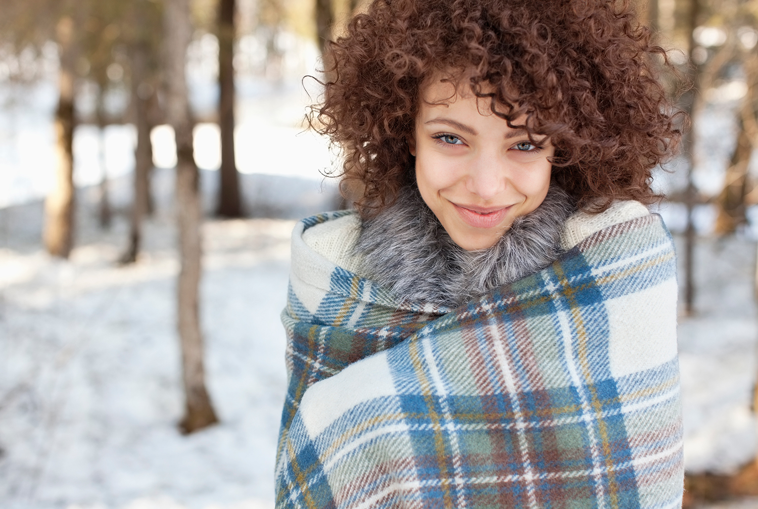 Woman Wrapped in Blanket Smiling