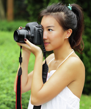 Woman with DSLR camera taking photos