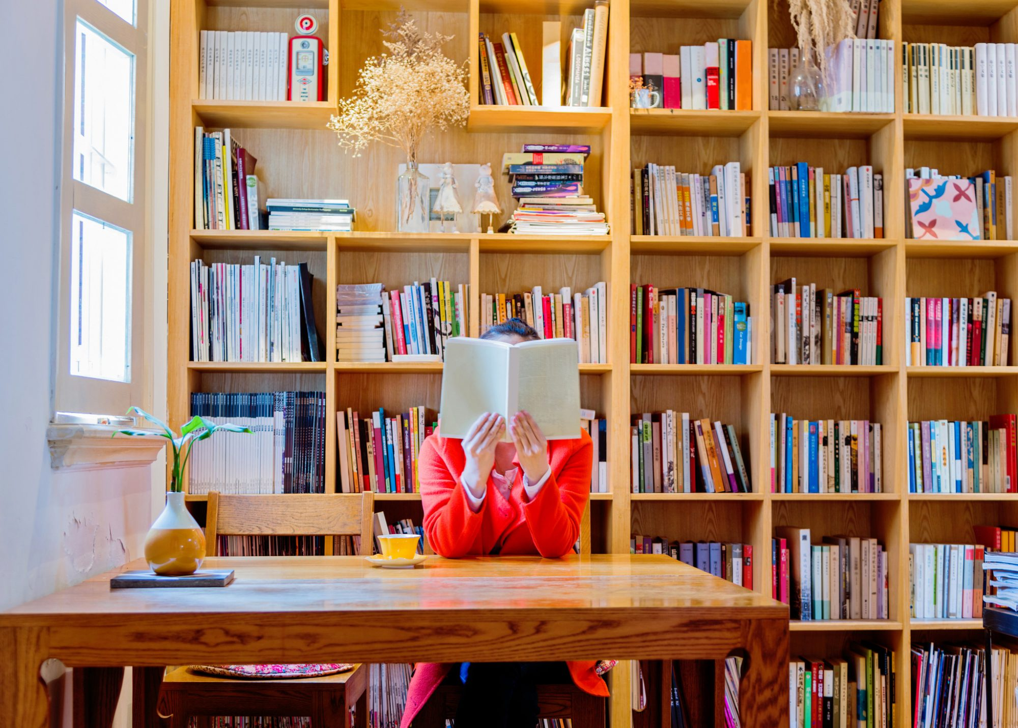 Woman reading in bookstore