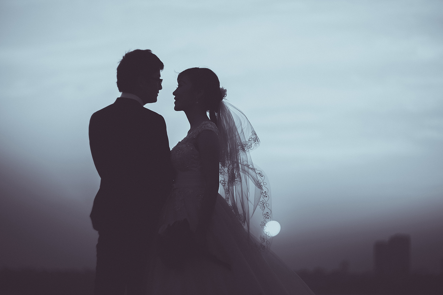 Bride and Groom at Dusk Embracing