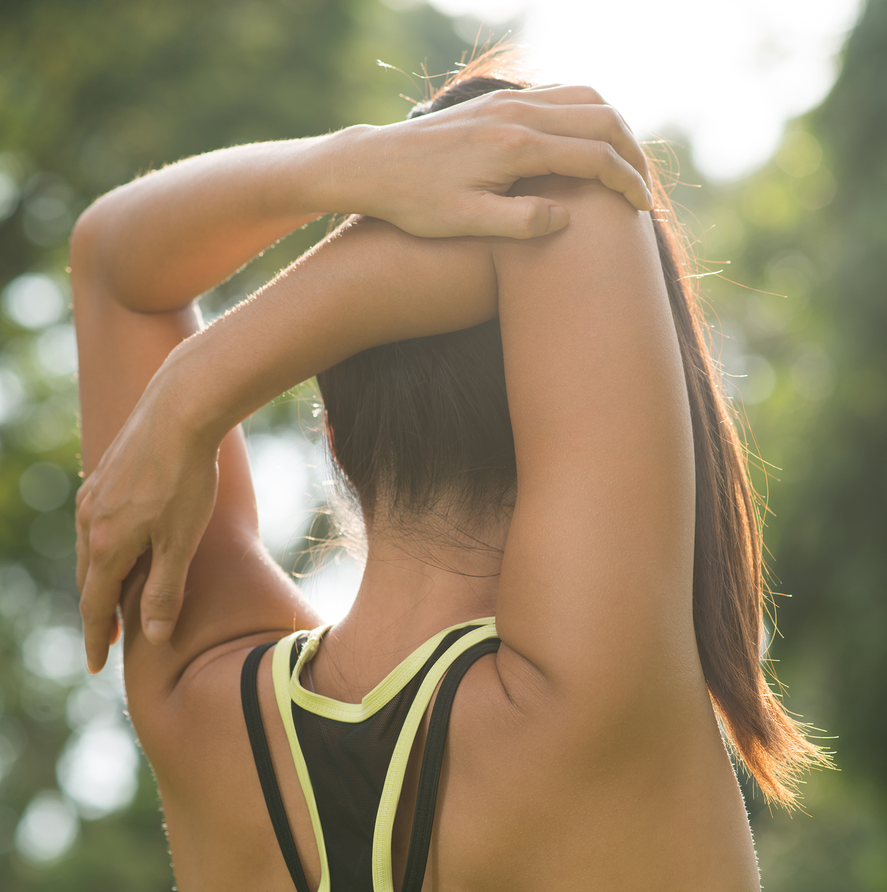 Woman stretching arm