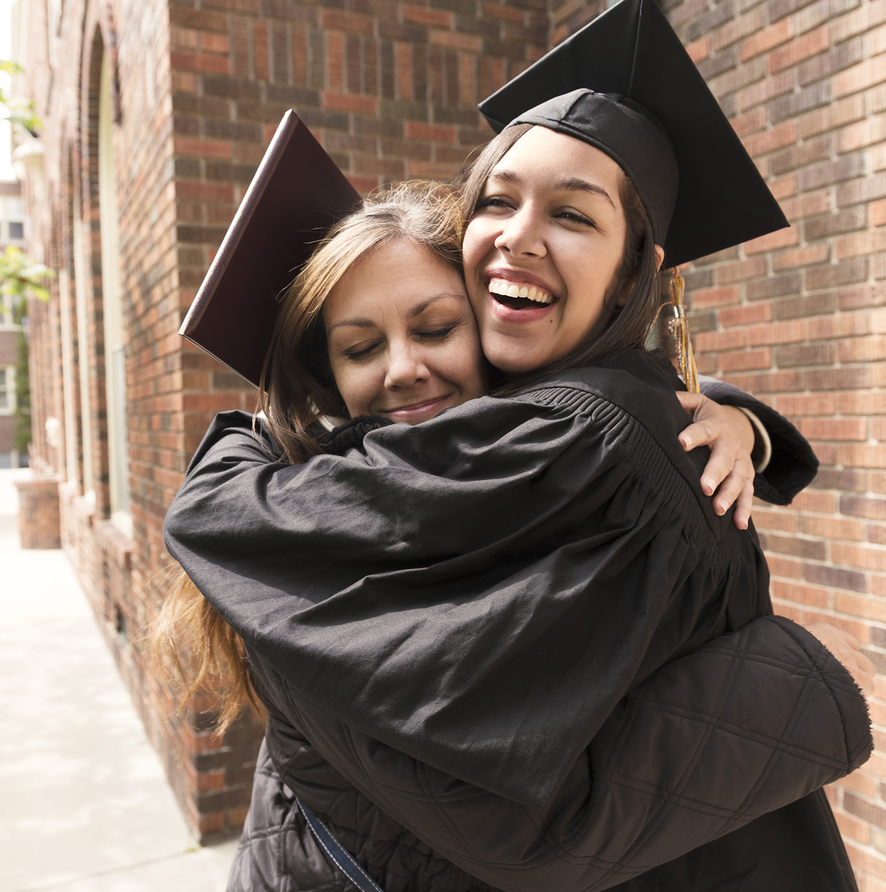 Mother and daughter hugging at graduation