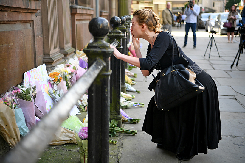Woman Showing Her Love for Manchester