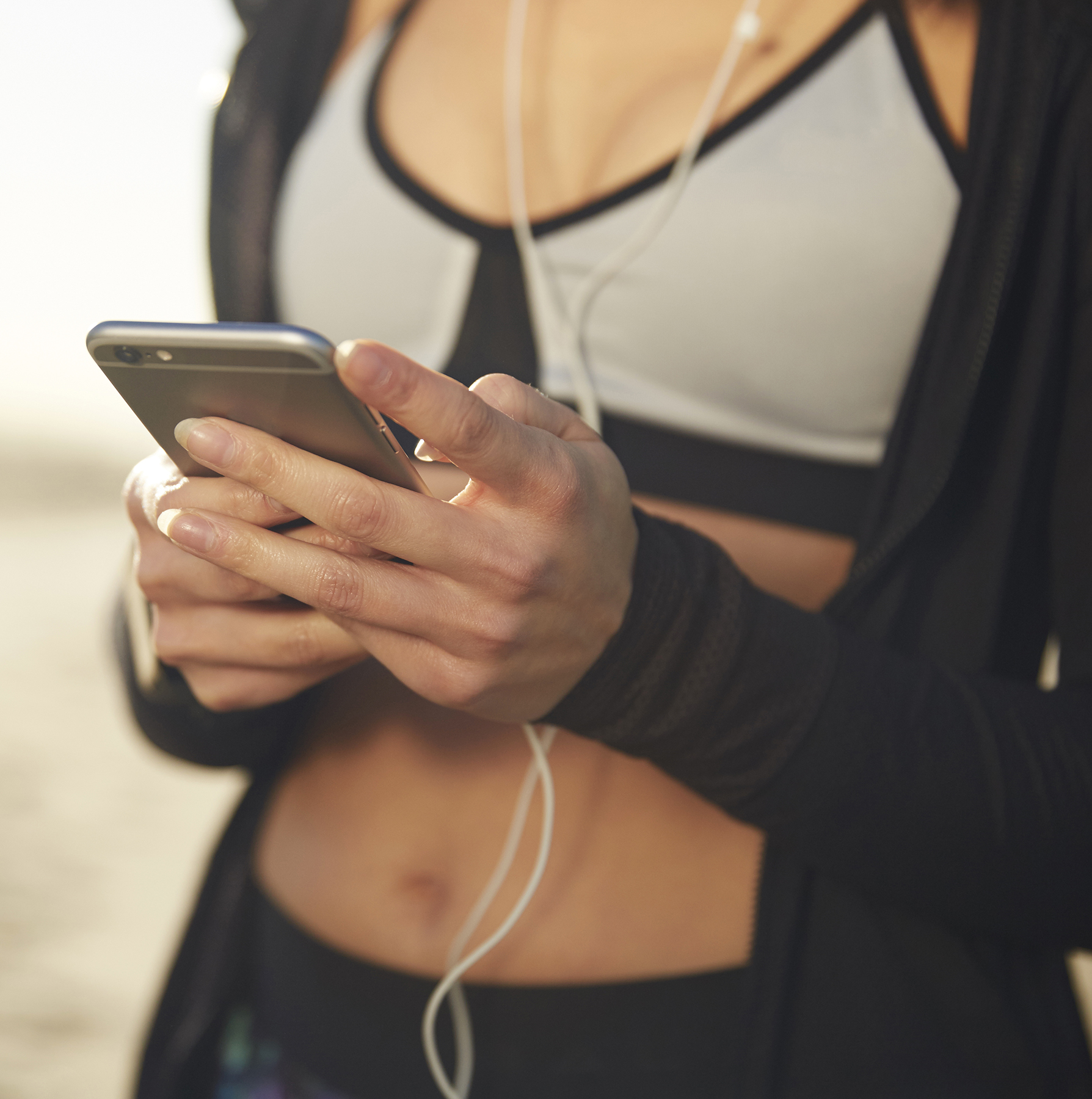 Running in sports bra with iphone
