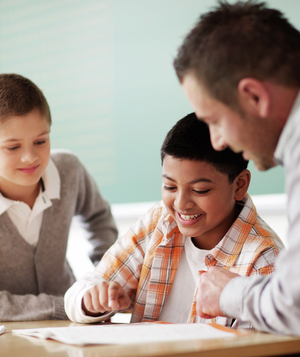 Two boys and teacher in classroom