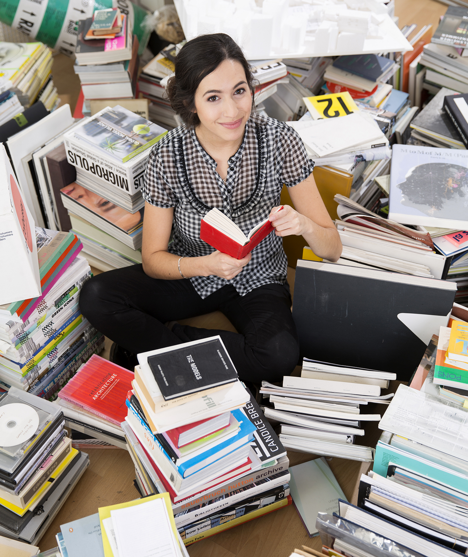Woman buried in books