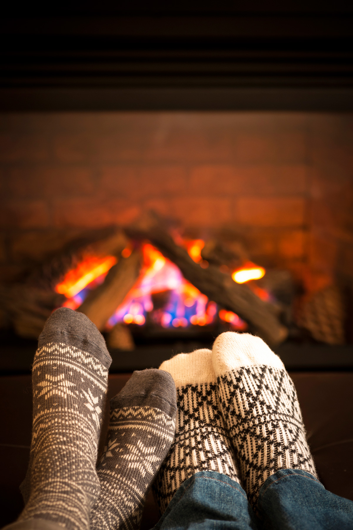 Two feet in front of fireplace
